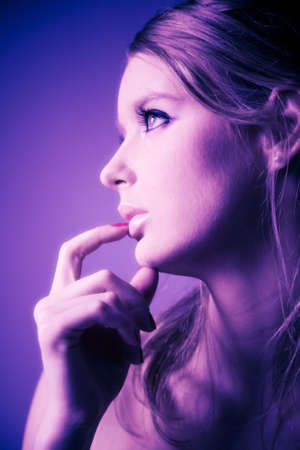 Young woman profile portrait. Soft blue and pink tint. Stock Photo - 5061213