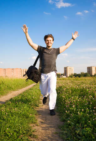 Young happy running man. On summer field background. Stock Photo - 5061244
