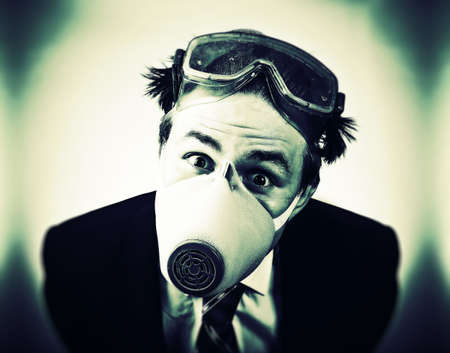 protective suit: Crazy man in protective mask and neck tie. High contrast colors. Stock Photo