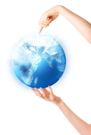 Woman hand holding shining globe. Isolated on white. photo