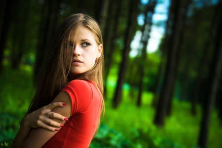 Lonely woman in a forest. Stock Photo