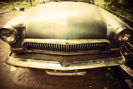 Old car front view. Retro colors. photo