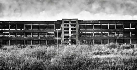 ruinous: Old ruinous factory panorama. Black and white horror concept. Stock Photo