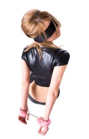 Young woman with pink handcuffs. Backside view. photo