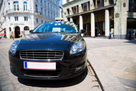 streetscene: Modern taxi in a city. Wide angle view. Stock Photo
