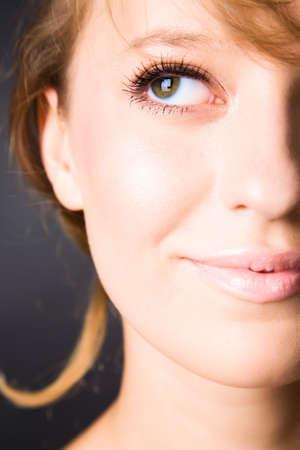 Young woman portrait. Right half of face. Stock Photo - 5159290
