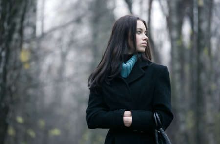 lonesome: Lonely woman in a forest. Autumn november season. Stock Photo