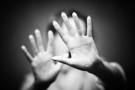 stop hand: Woman hands. Shallow dof. Black and white concept.