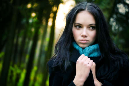 Young woman in forest. Mysterious portrait. photo