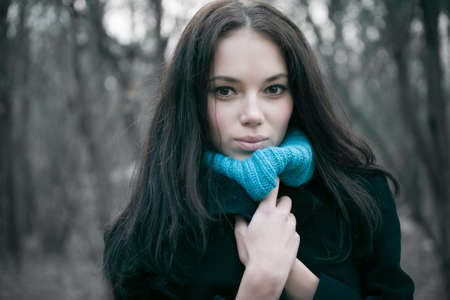 Young woman portrait. Cold autumn season. photo