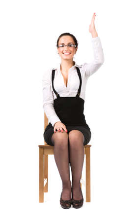 arm chair: Young businesswoman stretching up hand. Isolated on white.