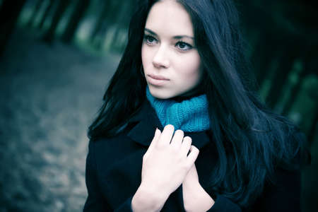 lonesome: Young woman portrait. Soft blue tint.