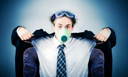 tinted glasses: Crazy businessman in protective mask. On soft blue background.