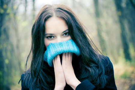 Woman portrait with big woollen collar for cold weather. photo
