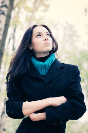 Young woman outdoors portrait. Soft yellow and blue tint. photo