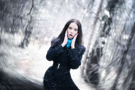 flaw: Young woman in a snowstorm. Background blur effect.
