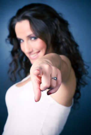 Smiling pointing woman. Focus on hand. Stock Photo - 5202618