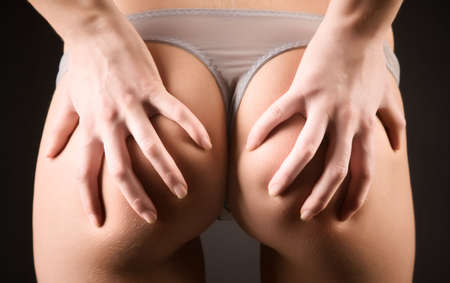 Sexy woman back. On dark background. Stock Photo - 5202663