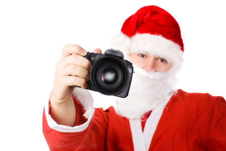 Santa Claus with modern digital camera. Isolated on white. photo