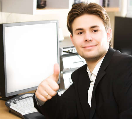 handsign: Happy businessman in office. Focus on face.