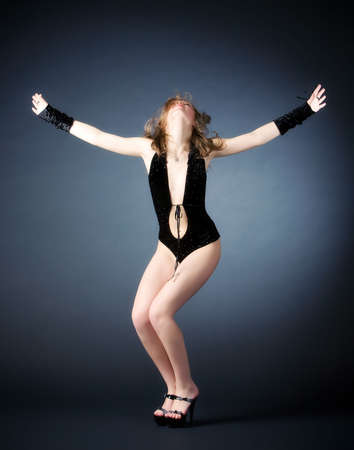 Young woman dancing. On dark background. Stock Photo - 5217087