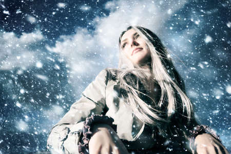 wide angle: Young blond woman in a blizzard. Wide angle view.