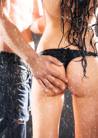 Man hand on sexy woman back. Water studio .