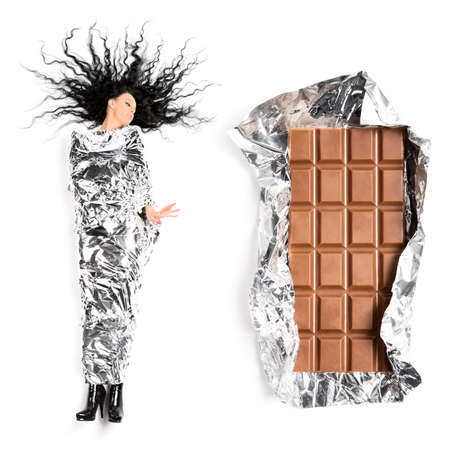 silver foil: Woman and chocolate. On white background. Stock Photo