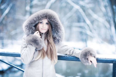 Young woman winter portrait. Soft blue tint. photo