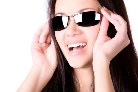 Young smiling woman with sunglasses. Isolated on white. photo