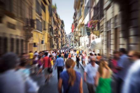 narrow: Crowd on a narrow Italian street. Motion blur effect. Stock Photo