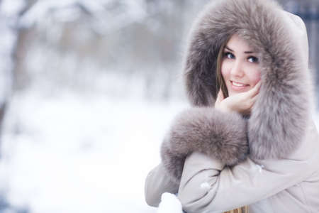 Young woman winter portrait. Shallow dof. photo