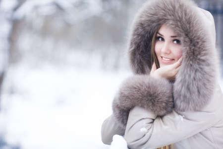 Young woman winter portrait. Shallow dof. photo