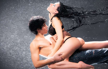 Young sexy couple. Water studio photo. Stock Photo - 5261712
