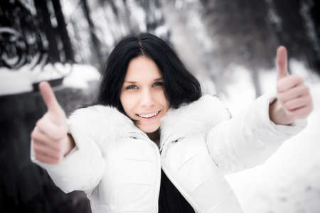 Happy woman showing excellent handsign. Winter season. Stock Photo