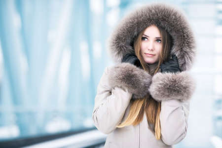 Young woman winter portrait. On abstract tech background. Stock Photo