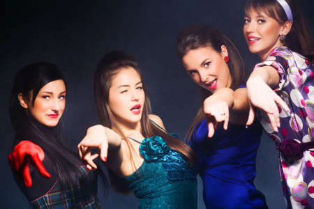 Cheerful party. Four women pointing to the camera. Stock Photo - 5265288