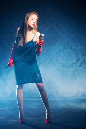 Young woman singer. Retro style. Stock Photo - 5265257