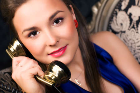 Young woman talking on phone. Retro style. Stock Photo - 5265299