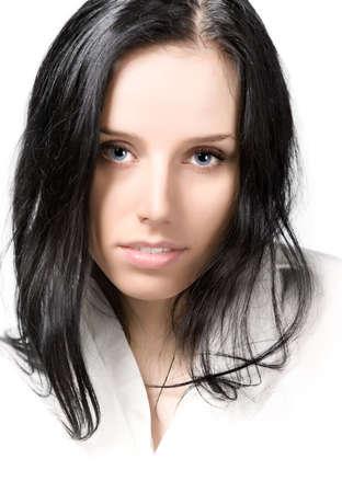 Young brunette woman portrait. High key photo. photo