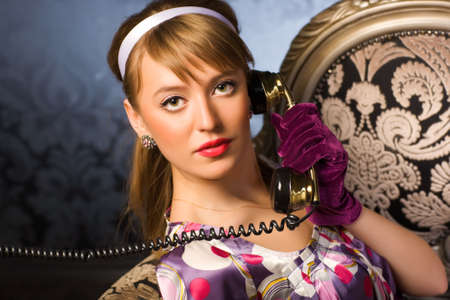 Young woman talking on phone. Retro style. Stock Photo - 5265262