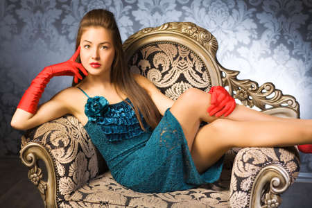 Young woman in a chair. Retro style. Stock Photo - 5265253