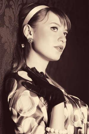 Young woman retro style portrait. Sepia colors. Stock Photo - 5265298