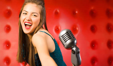 Young woman singer. Retro style. Stock Photo - 5265252