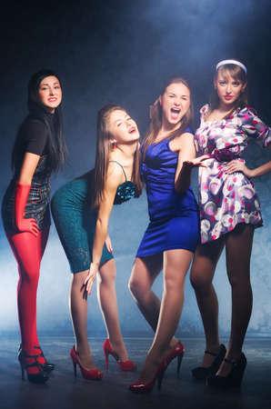 Four women on a party. Retro style. Stock Photo - 5265283