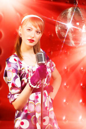 Young woman singer. Retro style. Stock Photo - 5282941
