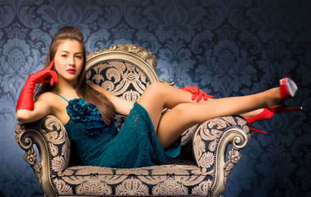 Young woman in a chair. Retro style. Stock Photo - 5283134