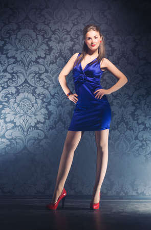 Young slim woman on wall background. Retro style. Stock Photo - 5283204