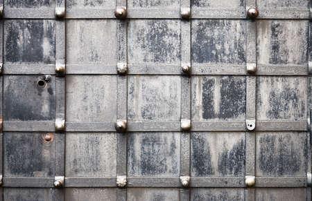 rivet: Old metallic wrought door closeup.