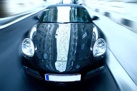 Sport car with special zoom blur effect. Blue tint. Stock Photo - 5291429
